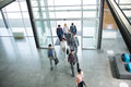 Group of professional business people walking in building Royalty Free Stock Photo