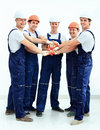 Group of professional industrial workers. Isolated over white background. Royalty Free Stock Photo