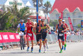 Group of professional ironman triathletes running leading international in the specsavers triathlon event in port elizabeth south Royalty Free Stock Photo