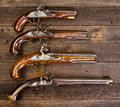Group of real flintlock pistols four i th century Stock Images