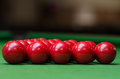 A group of red snooker balls on the green table Stock Images