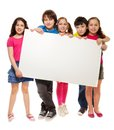 Group school aged teen boys girls showing blank placard board to write your own text isolated white background Stock Photo