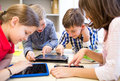 Royalty Free Stock Photography Group of school kids with tablet pc in classroom