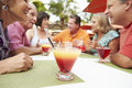 Group of senior friends enjoying cocktails in bar together Royalty Free Stock Image