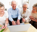 A group of senior people using laptop Stock Images