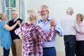 Group Of Seniors Enjoying Danc...