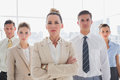Group of serious business team standing together with their arms crossed Royalty Free Stock Photo