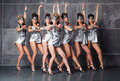 Group of seven happy cute girls in silver go-go costume Royalty Free Stock Image