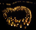 Group of several candles as a form heart Royalty Free Stock Photos
