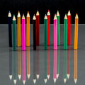 Group of sharp colored pencils with reflexions on dark background Stock Photo
