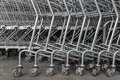 Group of shopping carts, wheels in front of supermarket Royalty Free Stock Photo