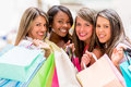 Group of shopping women holding bags ant looking happy Stock Images