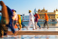 Group of Sikh pilgrims walking by the Golden Temple Stock Image
