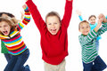 Group of six kids  jumping with joy and happiness Royalty Free Stock Photos