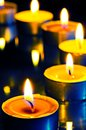 A group of small candles on dark background Royalty Free Stock Photo