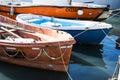 Group of small Italian fishing boats; working row-boats with fishing paraphernalia etc Royalty Free Stock Photo