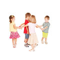 Group of small kids dancing having fun holding hands and joyful party isolated on white background Royalty Free Stock Photography