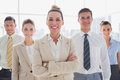 Group of smiling business team standing together with their arms folded Royalty Free Stock Photo