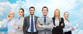 Group of smiling businessmen over blue sky Royalty Free Stock Photo