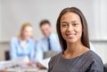 Group of smiling businesspeople meeting in office Royalty Free Stock Photo