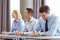 Group of smiling businesspeople meeting in office business people and teamwork concept on presentation Stock Photo