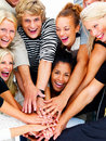 Group of smiling friends with hands on hands Royalty Free Stock Photography