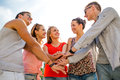 Group of smiling friends with hands on top in city friendship leisure summer gesturer and people concept Stock Photos