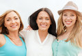 Group of smiling girls chilling on the beach summer holidays and vacation concept Royalty Free Stock Photography