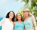 Group of smiling girls chilling on the beach summer holidays and vacation concept Royalty Free Stock Photos