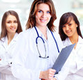 Group of smiling hospital colleagues portrait standing together Stock Photography