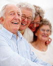 Group of smiling older people together Stock Photography