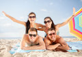 Group of smiling people having fun on the beach summer holidays vacation and happy concept in sunglasses Stock Images