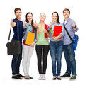 Group of smiling students showing thumbs up education and people concept standing and Royalty Free Stock Image