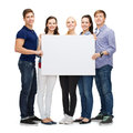 Group of smiling students with white blank board education advertisement sale and people concept Royalty Free Stock Photography