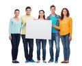 Group of smiling teenagers friendship youth and people with big white blank billboard Royalty Free Stock Photography