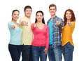 Group of smiling teenagers friendship youth and people concept pointing fingers on you Royalty Free Stock Photos