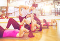 Group of smiling women doing sit ups in the gym Royalty Free Stock Photo