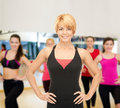 Group of smiling women exercising in the gym fitness sport training and lifestyle concept with trainer Stock Photo