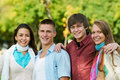 Group of smiling young students outdoors Stock Photo