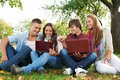 Group of smiling young students outdoors Royalty Free Stock Photo