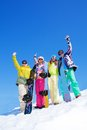 Group of snowboard friends four happy stand together with snowboards in snow in winter Stock Photography