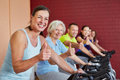 image photo : Group in spinning class holding