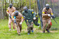 Group of sportsmen on start of paintball mission Royalty Free Stock Photo