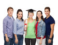Group of standing smiling students with diploma education and people concept and corner cap Stock Images