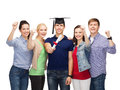 Group of standing smiling students with diploma education and people concept and corner cap Royalty Free Stock Photo
