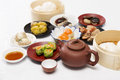 Group of stream Dim Sum chinese food and hot Tea Royalty Free Stock Photo
