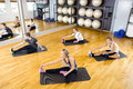 Group stretching exercises for muscle flexibility at fitness center