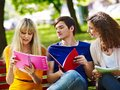 Group student with notebook on bench outdoor happy Stock Photo