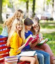 Group student with notebook outdoor on bench Stock Photos