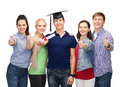 Group of students with diploma showing thumbs up education and people concept standing smiling and corner cap Royalty Free Stock Photos